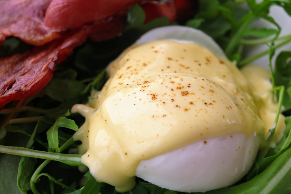 Poached eggs is a popular choice when eating out for breakfast. Learn how to poach eggs with this easy step by step guide. You will definitely save money.