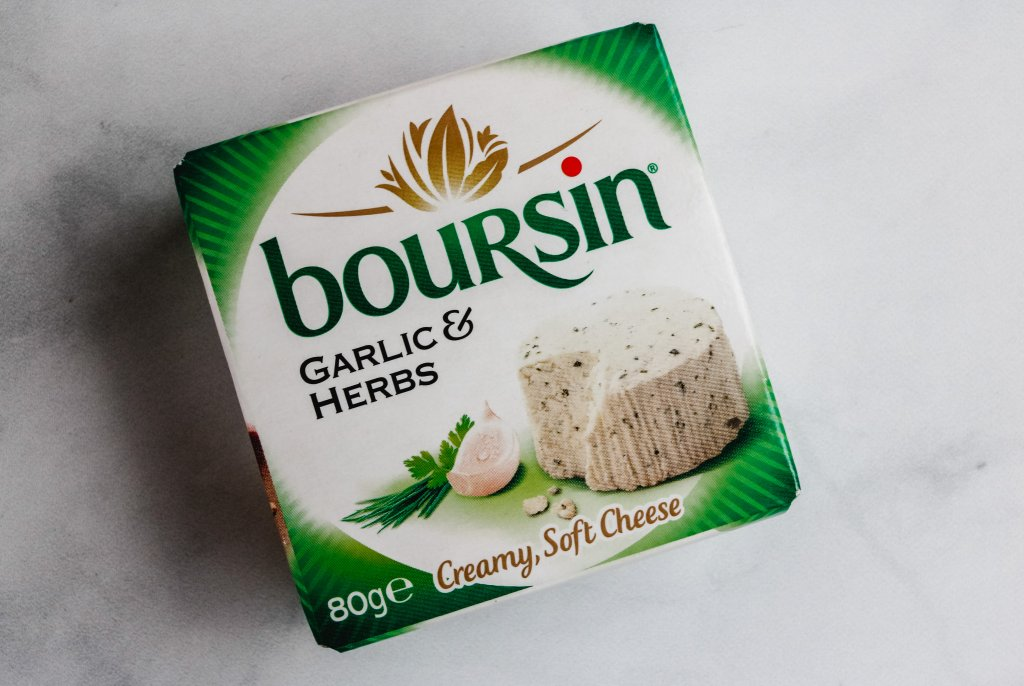 A box package of boursin cheese on a white background.