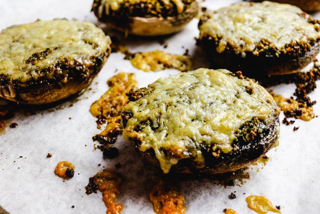 4 stuffed mushrooms on a baking tray