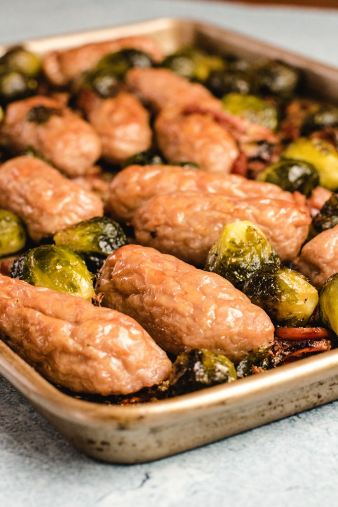 Keto sausage tray bake on a golden baking tray